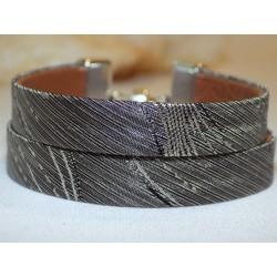 Bracelet cuir et tissu...